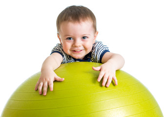 kid girl doing fitness exercise with fitness ball