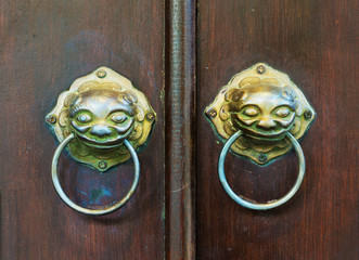 chinese door with a lion head.