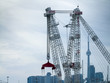 Crane with city in the background, CN Tower, Lake Ontario, Toron