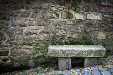 Bench in front of a stone wall, Dinan, Cotes-D'Armor, Brittany,