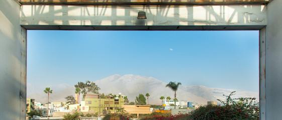 City viewed through window, Lima, Peru