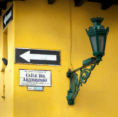 Lantern mounted with a yellow wall, Lima, Peru