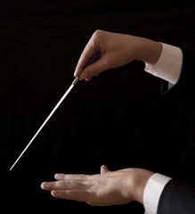 Music male director holding stick