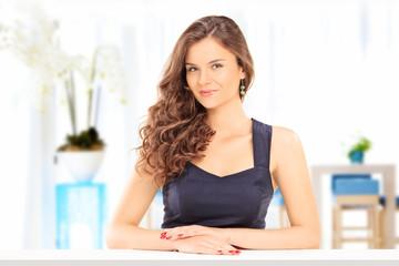 Beautiful woman posing at a table indoors