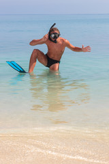 Funny scuba diver at the beach