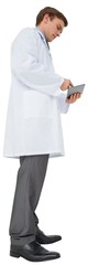 Young doctor in lab coat using tablet pc