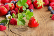 Fresh berries on a wooden background. Selective focus