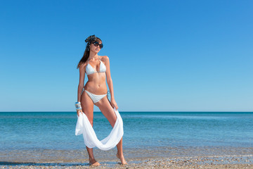 Portrait of a woman with beautiful body on the beach
