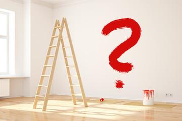 Fragezeichen an Wand bei Renovierung