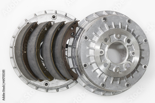 Brake shoes and drums on a white background - 64705381