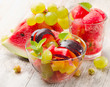 Fruit salad on wooden table