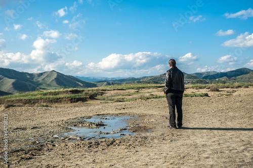 Deurstickers Canarische Eilanden Man standing alone at muddy volcanoes