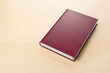 New red hardcover book with blank cover