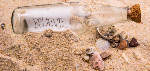 Concept image of a message BELIEVE in a bottle