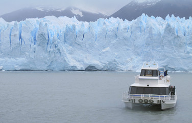 Patagonian landscape with glacier, lake and boat