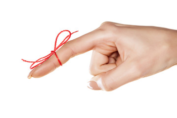 woman's finger bound with red thread