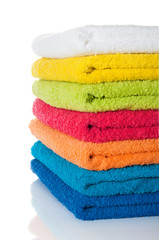 Stack of colorful towels on white