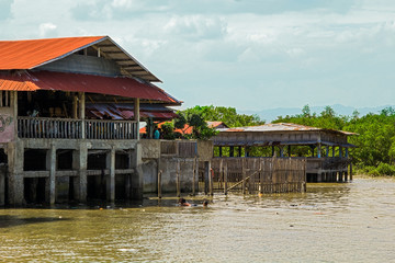 Stilted houses and the river, Philippines
