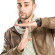 Handsome man doing the timeout sign over white background