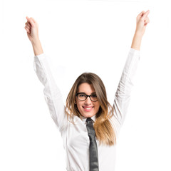 Young businesswoman winning on white background