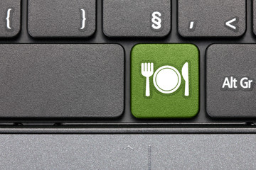Organic food. Green hot key on computer keyboard.