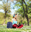Woman with headphones studying in park