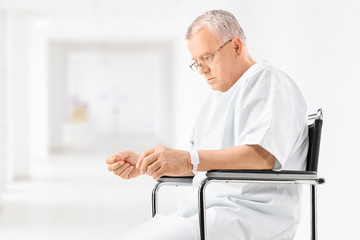 Worried mature patient sitting in a hospital corridor