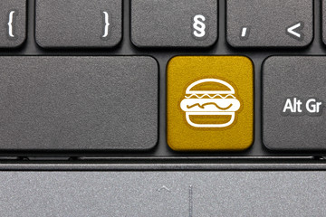Fast food. Yellow hot key on computer keyboard.