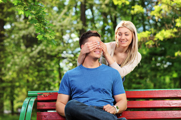 Young woman covering the eyes of her boyfriend