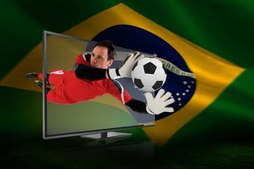 Fit goal keeper saving goal through tv