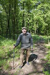 The senior man by nordic walking