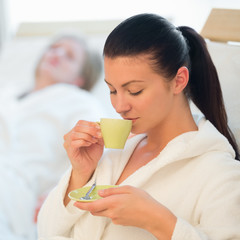 Woman drink coffee at spa