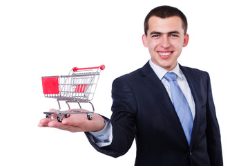 Businessman with shopping cart on white