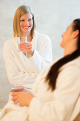 Women drink water at beauty spa