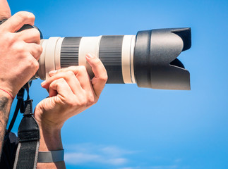 Photographer with big zoom digital lens