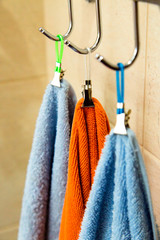 Three towels hanging on a hook