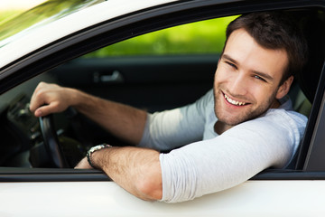 Young man sitting in a car