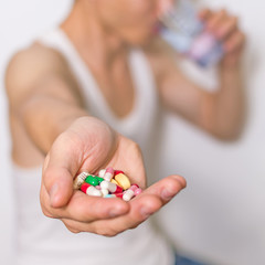 Pills, tablets capsules heap in  hand, close up view