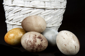 Natural dyed easter eggs in white wicker basket