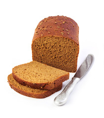 Loaf of rye bread with slices and knife