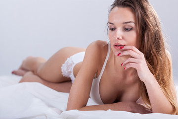 Woman in bed waiting for partner