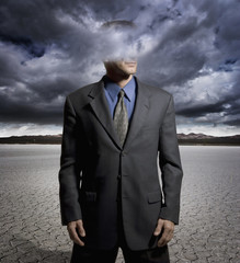 Digital composite of a man with his head in the clouds