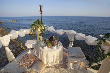 Table set for a life event near the sea.