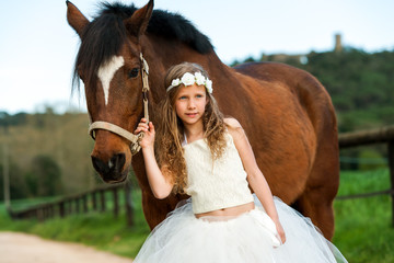 Cute girl standing next to horse.