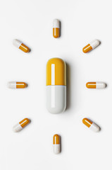 Large pill surrounded by small pills
