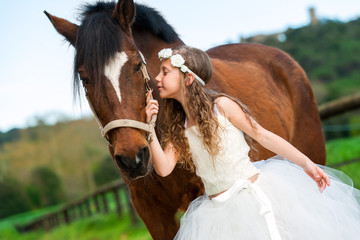 Girl giving horse a kiss