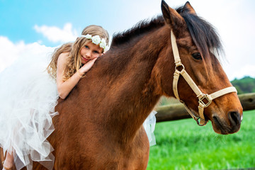 Girl relaxing on horseback.