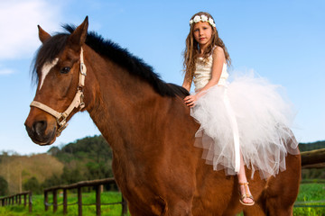 Sweet girl riding horse.
