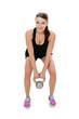 Frau macht Workout mit Kettlebell