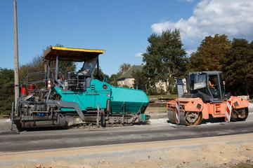 A couple of asphalt paving machines